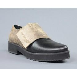 Zapato dorado y negro.svu9